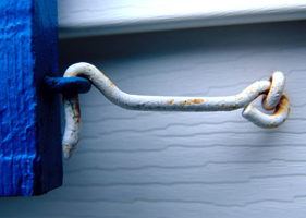 Photograph of a rusted window hook