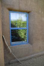 Photograph of Blue Window with Ristra