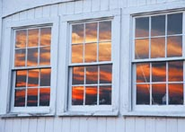 Photograph of Sunset in a Barn Window